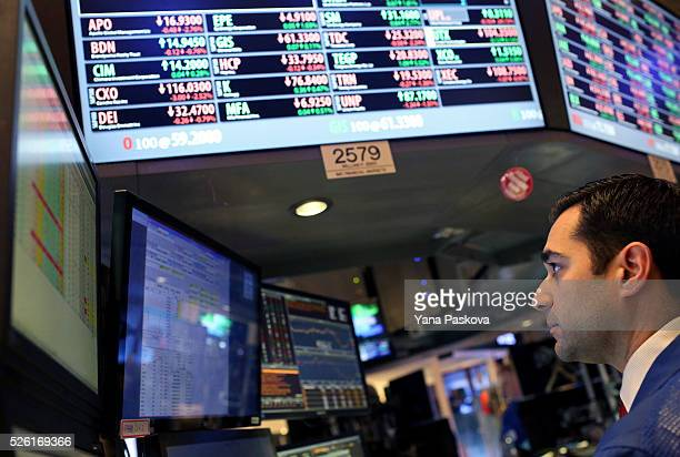 A trader works on the floor of the New York Stock Exchange on April 29 2016 in New York City The Dow Jones Industrial Average closed down over 100...