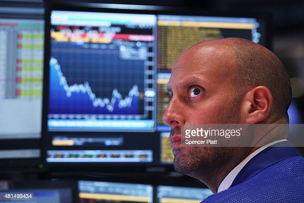 A trader works on the floor of the New York Stock Exchange on July 21 2015 in New York City The Dow fell over 170 points partly on news that earnings...