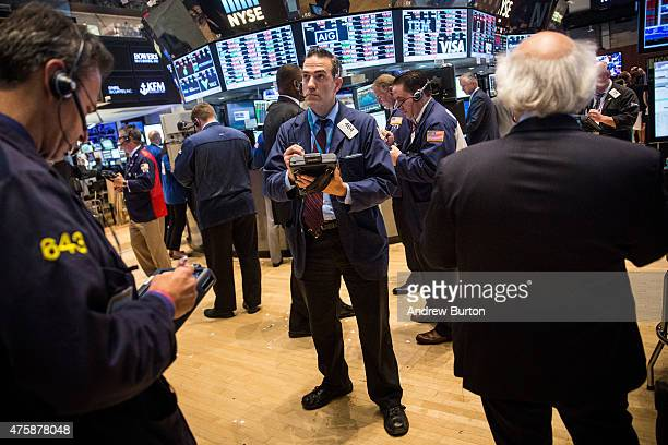 A trader works on the floor of the New York Stock Exchange on June 4 2015 in New York City The Dow Jones Industrial Average closed approximately 170...
