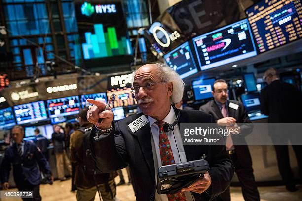 A trader works on the floor of the New York Stock Exchange on November 18 2013 in New York City The Dow Jones Industrial Average passed 16000 points...