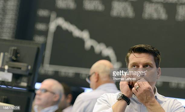 A trader works on the last day of trading for 2012 at the Frankfurt Stock Exchange on December 28 2012 in Frankfurt Germany The DAX index of...