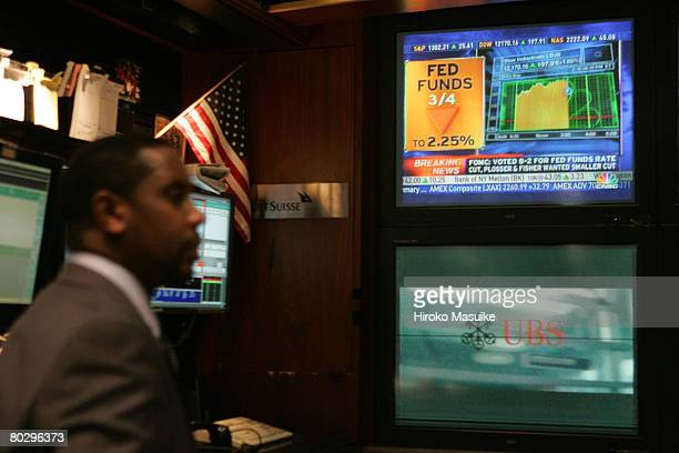 A trader works the floor of the New York Stock Exchange after the Fed board rate decision was announced March 18 2008 in New York City Stocks held on...