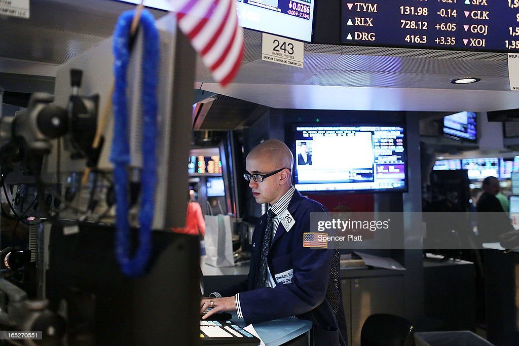 A trader works the floor of the New York Stock Exchange at the end of the trading day on April 2, 2013 in New York City. The Dow Jones Industrial average and the S&P 500 rose to new record highs on April 2, with the Dow finishing at a record close of 14,662. All three major indexes are up between about 10 percent and 12 precent for the year.