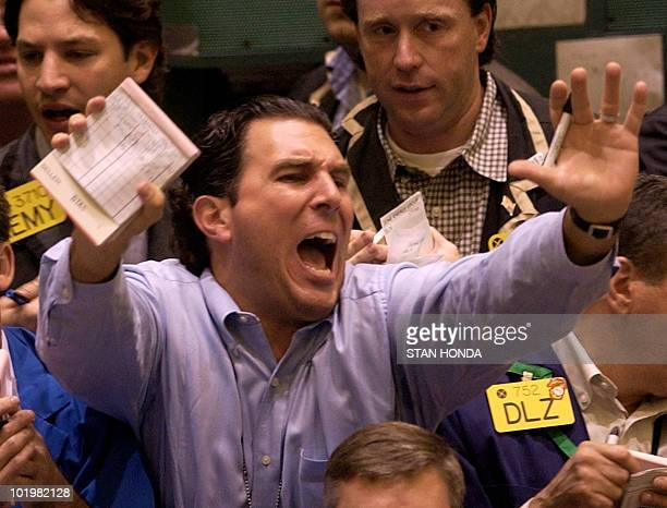 A trader yells for attention in the oil futures pit 13 October at the New York Merchantile Exchange Oil prices are falling from a high price of USD...