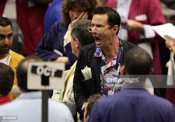 Traders and clerks signal prices in the Cattle Futures pit at the Chicago Mercantile Exchange during the first day of trading following the...