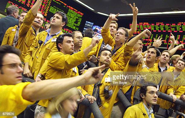 Traders and clerks work on the Eurodollar Futures floor of the Chicago Mercantile Exchange November 6, 2001 after the FOMC announced an interest rate...