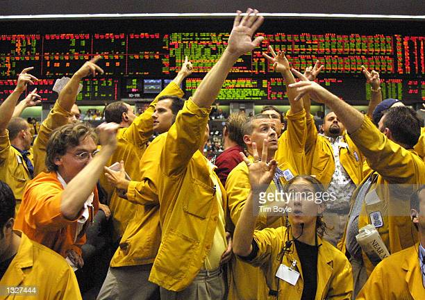 Traders and clerks work the floor of the Eurodollar trading pit at the Chicago Mercantile Exchange June 27, 2001 after the Federal Open Market...