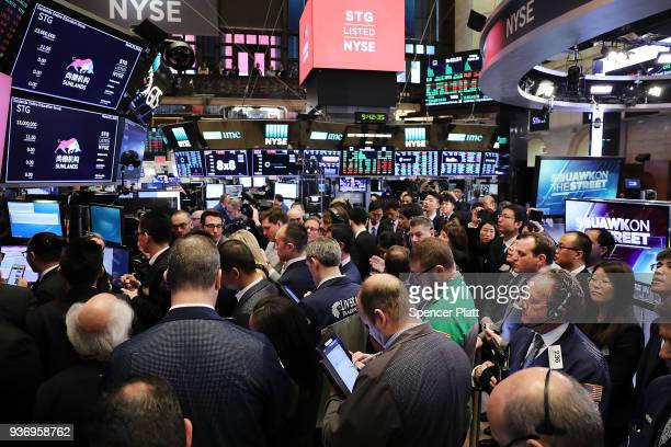 Traders and employees of Sunlands Online Education gather on the floor of the New York Stock Exchange during the Beijingbased firms IPO on March 23...