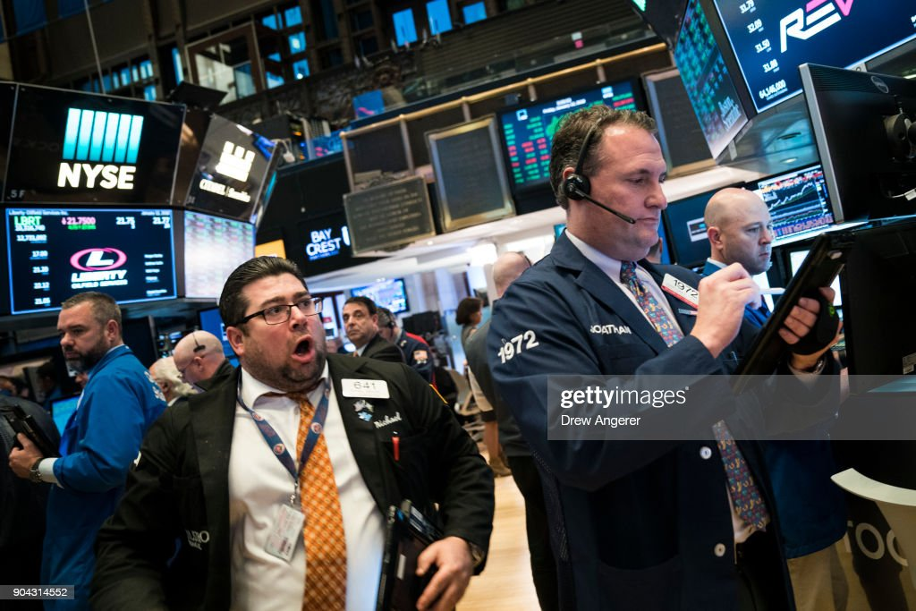 Traders and financial professional work ahead of the closing bell on the floor of the New York Stock Exchange (NYSE), January 12, 2018 in New York City. The Dow was up over 200 points on Friday, off to its best start to begin a year since 2003.