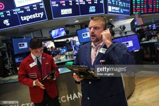 Traders and financial professionals work ahead of the closing bell on the floor of the New York Stock Exchange July 19 2018 in New York City Stocks...