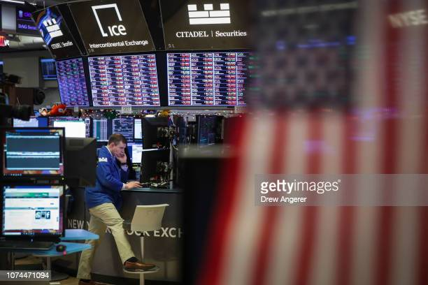 Traders and financial professionals work ahead of the closing bell on the floor to he New York Stock Exchange December 20 2018 in New York City The...