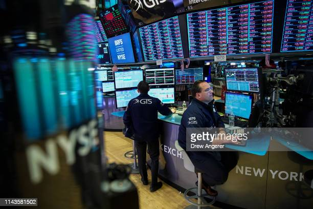 Traders and financial professionals work ahead of the closing bell on the floor of the New York Stock Exchange , May 13, 2019 in New York City. U.S....