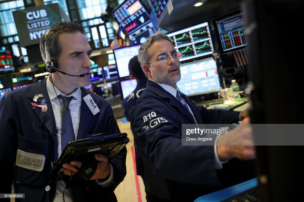 Traders and financial professionals work ahead of the closing bell on the floor of the New York Stock Exchange (NYSE) June 13, 2018 in New York City. Following news today that the Federal Reserve raised interest rates a quarter percentage point, the Dow Jones Industrial Average was down 119 points at the close.