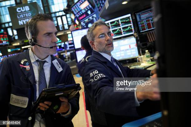 Traders and financial professionals work ahead of the closing bell on the floor of the New York Stock Exchange June 13 2018 in New York City...