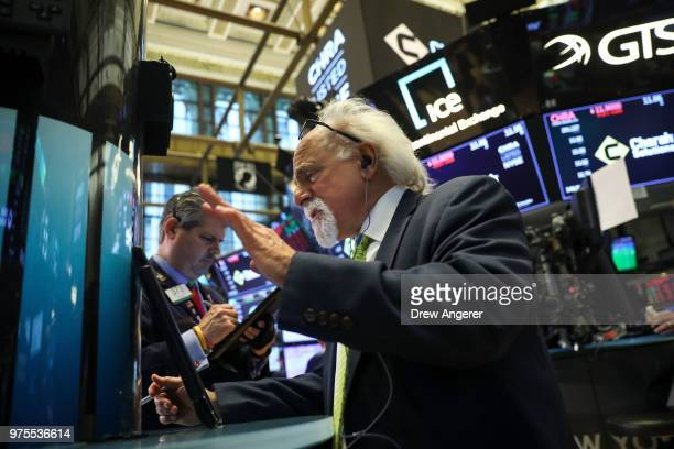 Traders and financial professionals work ahead of the closing bell on the floor of the New York Stock Exchange June 15 2018 in New York City On...