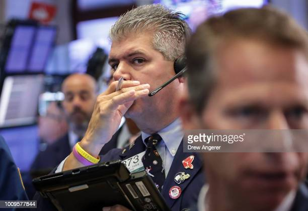 Traders and financial professionals work on the floor of the New York Stock Exchange at the opening bell August 2 2018 in New York City The Dow Jones...