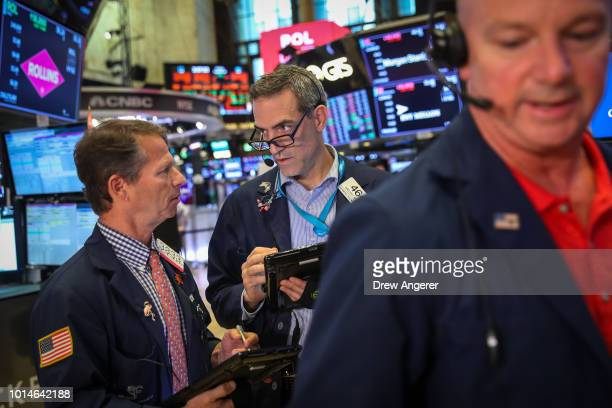 Traders and financial professionals work on the floor of the New York Stock Exchange ahead of the closing bell on August 10 2018 in the Brooklyn...