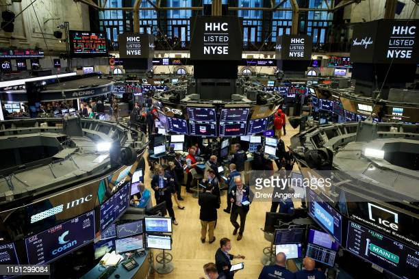 Traders and financial professionals work on the floor of the New York Stock Exchange ahead of the closing bell, June 21, 2019 in New York City. U.S....