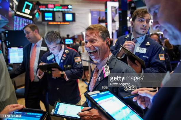 Traders and financial professionals work on the floor of the New York Stock Exchange at the closing bell on October 2, 2019 in New York City. The Dow...