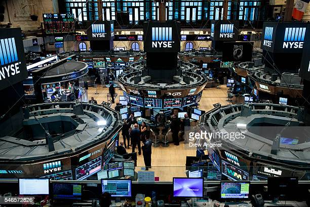 Traders and financial professionals work on the floor of the New York Stock Exchange July 12 2016 in New York City The Dow Jones industrial average...