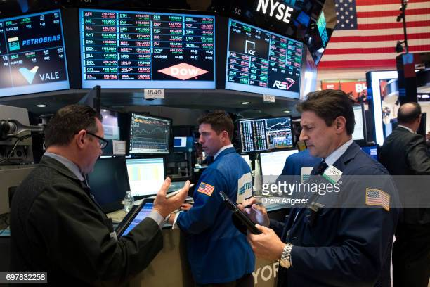 Traders and financial professionals work on the floor of the New York Stock Exchange ahead of the closing bell June 19 2017 in New York City As tech...