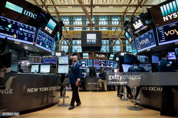 Traders and financial professionals work on the floor of the New York Stock Exchange ahead of the closing bell August 2 2017 in New York City The Dow...