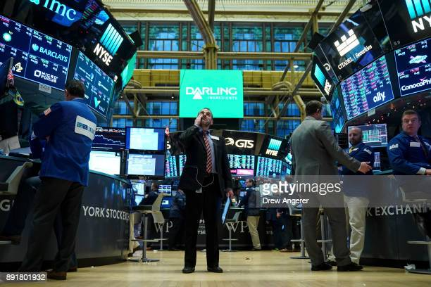 Traders and financial professionals work on the floor of the New York Stock Exchange ahead of the closing bell December 13 2017 in New York City The...