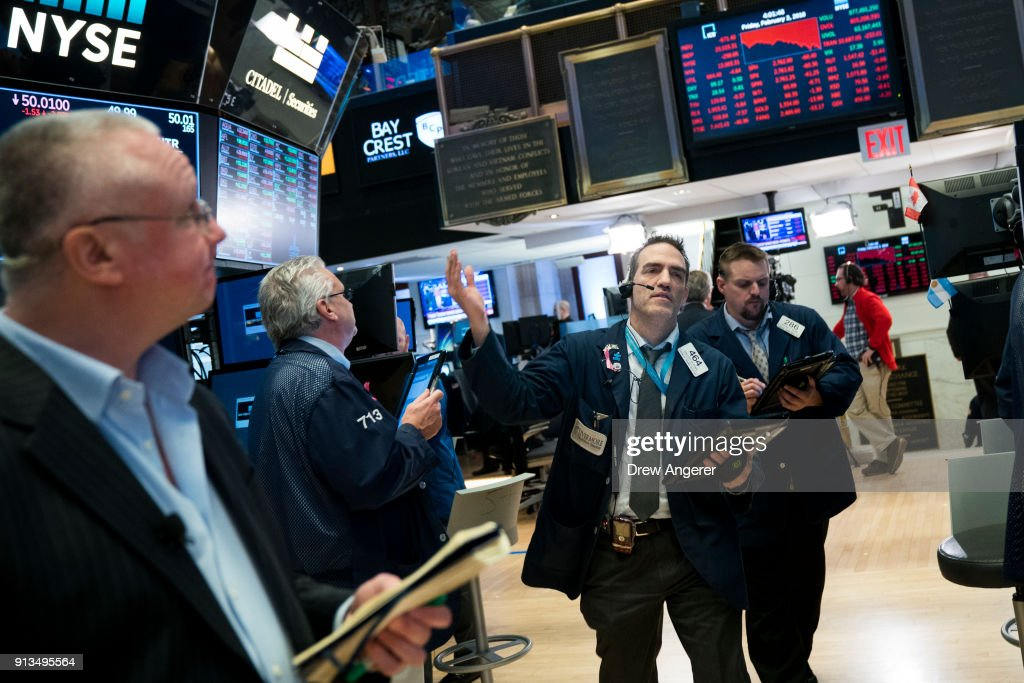Traders and financial professionals work on the floor of the New York Stock Exchange (NYSE) at the closing bell, February 2, 2018 in New York City. The Dow dropped 250 points at the open on Friday morning. The Dow plunged over 660 points on Friday, marking its biggest one day plunge since June 2016 following the Brexit vote.