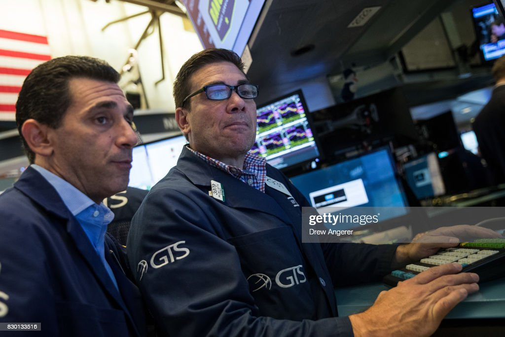 Traders and financial professionals work the floor of the New York Stock Exchange (NYSE) ahead of the opening bell, August 11, 2017 in New York City. After a week of tension and rhetoric between the United States and North Korea, stocks were on the rise for the first time in four days.