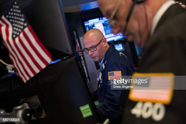 Traders and financial professionals work the floor of the New York Stock Exchange ahead of the opening bell August 11 2017 in New York City After a...