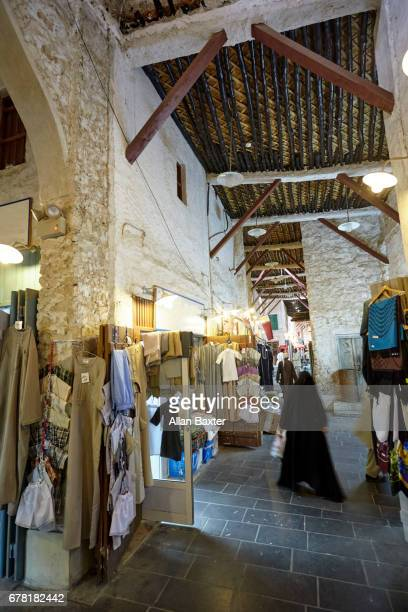 Traders and tourists in the interior of Doha's Souq Waqif