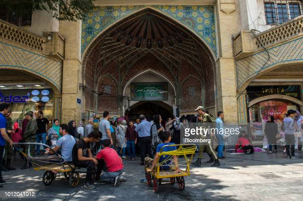 Traders and visitors mingle at the entrance to the Grand Bazaar in Tehran Iran on Monday Aug 6 2018 Irans central bank acting on the eve of US...