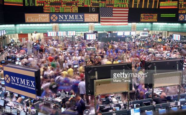 Traders are blurred during a long exposure as they work in the oil futures pit at the New York Mercantile Exchange July 14 2006 in New York City...
