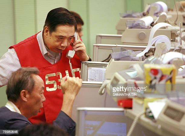 Traders are seen as the Hong Kong Stock exchange closes, in Hong Kong, 06 August 2007. The Hang Seng Index closed down 601.71 points or 2.67 percent...