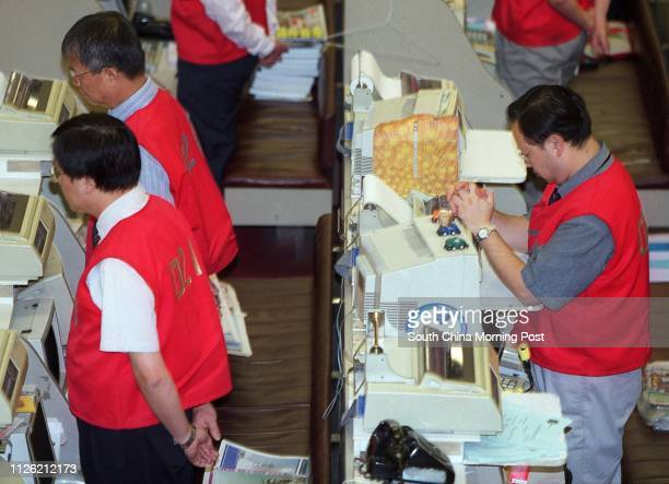 Traders at the Hong Kong Stock Exchange observe a minutesilence to mourn those killed in terrorist attacks in the United States prior to the start of...