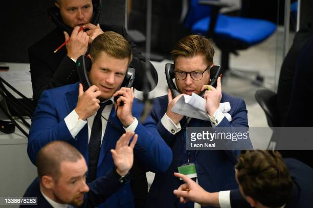 Traders, brokers and clerks shout and gesture on the first day of in-person trading at the London Metal Exchange on September 06, 2021 in London,...