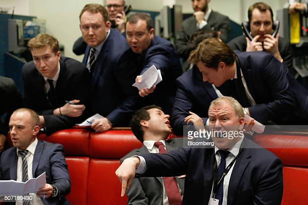 Traders, brokers and clerks shout and gesture on the trading floor of the open outcry pit at the London Metal Exchange , on the last day of trading...