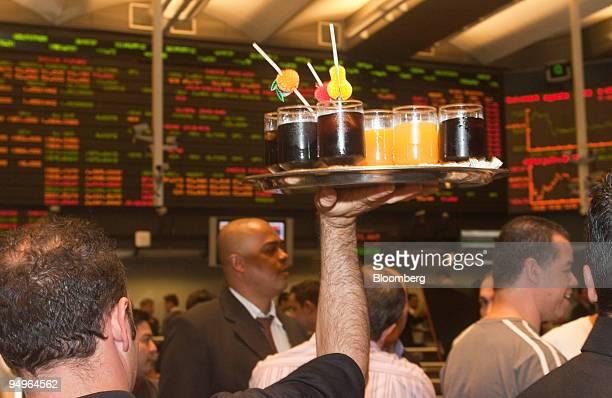 Traders celebrate the end of derivatives pit trading at the Brazilian Bolsa de Mercadorias e Futuros or Brazilian Mercantile and Futures Exchange in...