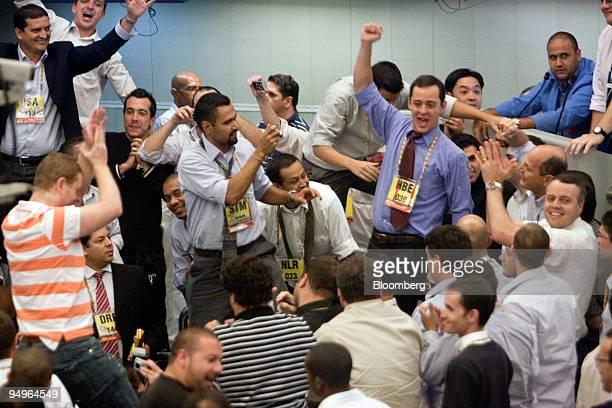 Traders celebrate the last minutes of derivatives pit trading at the Brazilian Bolsa de Mercadorias e Futuros or Brazilian Mercantile and Futures...