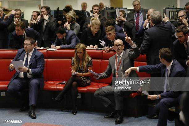 Traders, clerks and brokers react on the trading floor of the open outcry pit at the London Metal Exchange , on the last day of trading at their...