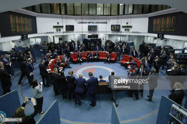 Traders, clerks and brokers work on the trading floor of the open outcry pit at the London Metal Exchange , on the last day of trading at their...