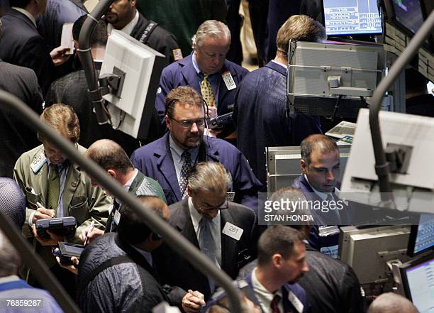 Traders crowd the floor of the New York Stock Exchange after the opening bell 19 September 2007 in New York US stocks opened higher Wednesday...