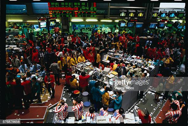 Traders deal their stocks on the Stock Exchange floor of Singapore