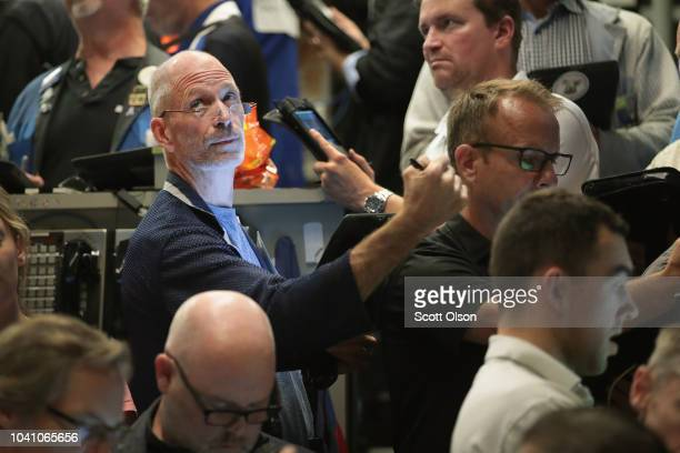 Traders fill orders in the SP options pit at the Cboe Global Markets exchange shortly after the Federal Reserve announced it was raising interest...