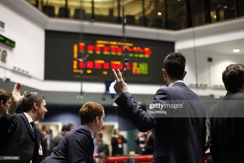 Traders gesture as they work on the trading floor of the London Metal Exchange (LME) in London, U.K., on Friday, Dec. 7, 2012. The London Metal Exchange's $2.2 billion takeover by the Hong Kong Exchanges & Clearing Ltd. was completed yesterday. Photographer: Simon Dawson/Bloomberg via Getty Images