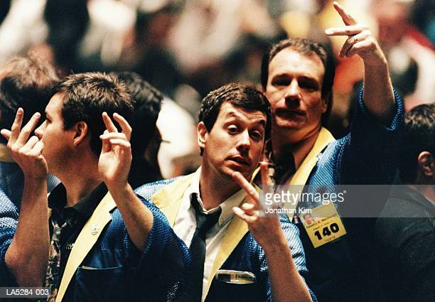 traders gesturing on stock trading floor, usa - bull market stock pictures, royalty-free photos & images