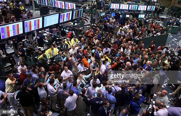 Traders in crude oil and natural gas options work on the floor of the New York Mercantile Exchange on June 3 2009 in New York City Following gains...