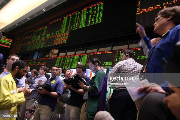 Traders in crude oil and natural gas options work on the floor of the New York Mercantile Exchange on June 10 2009 in New York City Crude futures...