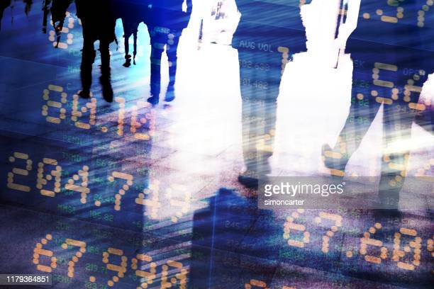 traders in financial district with trading screen data. - global stock pictures, royalty-free photos & images