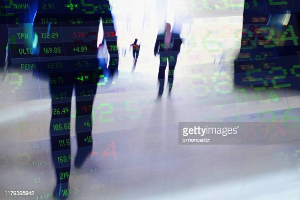 traders in financial district with trading screen data. - financial technology stock pictures, royalty-free photos & images